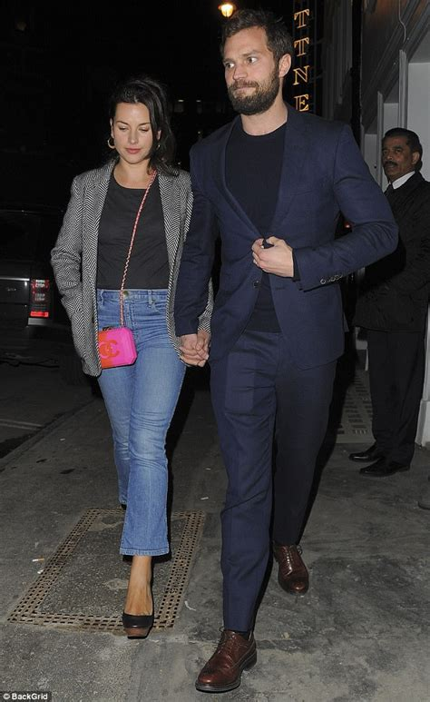 Jamie Dornan holds hands with his wife at Soho House party
